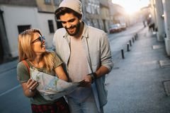 Smiling couple travelling and having fun in the city. Summer holidays, dating and tourism concept. royalty free stock photo