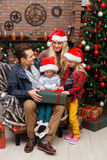 Smiling couple and two children Stock Images