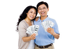 Smiling couple with two fans of cash Royalty Free Stock Image