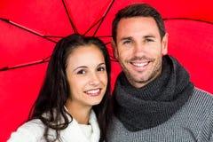 Smiling couple under umbrella Royalty Free Stock Photos
