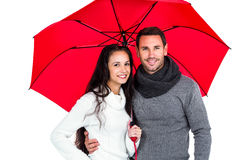 Smiling couple under umbrella Stock Photography