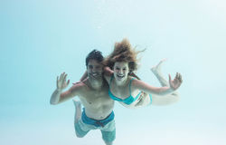 Smiling couple under water Stock Photography