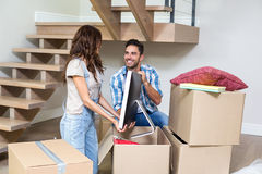 Smiling couple unpacking computer from cardboard box Stock Image