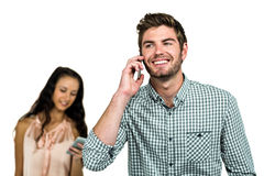 Smiling couple using cellphones Stock Photo