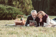 Smiling couple using digital tablet Royalty Free Stock Image