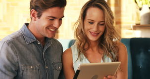 Smiling couple using digital tablet stock video