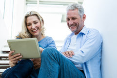 Smiling couple using digital tablet Stock Photo