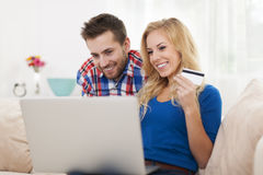 Smiling couple using laptop Royalty Free Stock Image