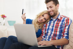 Smiling couple using laptop Stock Photos