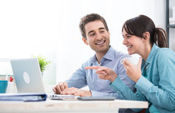 Smiling couple using a laptop Stock Photo