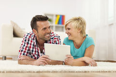 Smiling couple using tablet Stock Images