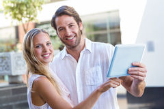 Smiling couple using tablet computer Stock Photos