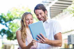 Smiling couple using tablet computer Stock Photography