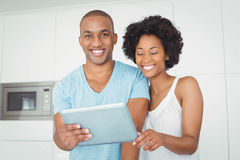 Smiling couple using tablet Royalty Free Stock Photo