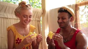 Smiling couple on vacation having a breakfast stock footage