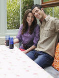 Smiling Couple At Verandah Table Stock Photo