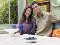 Smiling Couple At Verandah Table Royalty Free Stock Photography