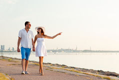 Smiling couple walking outdoors Royalty Free Stock Images