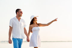 Smiling couple walking outdoors Royalty Free Stock Image