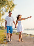 Smiling couple walking outdoors Royalty Free Stock Photos