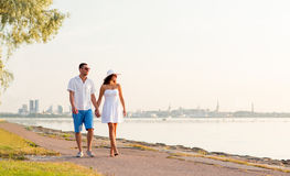 Smiling couple walking outdoors Stock Photo