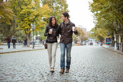 Smiling couple walking outdoors Stock Photography