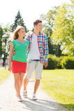 Smiling couple walking in park Stock Photo