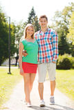 Smiling couple walking in park Royalty Free Stock Photo