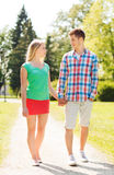 Smiling couple walking in park Stock Photos