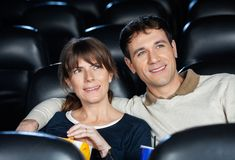 Smiling Couple Watching Movie In Theater Royalty Free Stock Photos