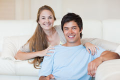 Smiling couple watching television Stock Photo