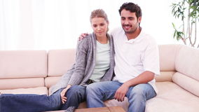 Smiling couple watching the television stock video