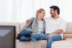 Smiling couple watching TV Stock Images