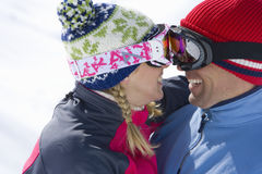 Smiling couple wearing goggles, hugging Stock Images