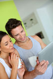 Smiling couple websurfing on internet Stock Photo