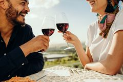 Smiling couple on a wine date stock image