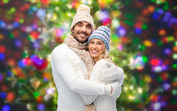 Smiling couple in winter clothes hugging Royalty Free Stock Photo