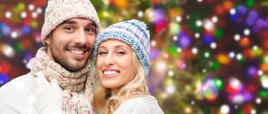 Smiling couple in winter clothes hugging Stock Images