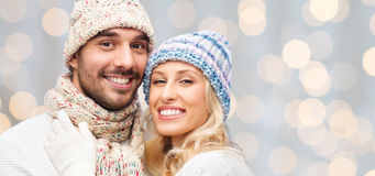 Smiling couple in winter clothes hugging Royalty Free Stock Image