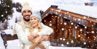 Smiling couple in winter clothes hugging outdoors Stock Photography