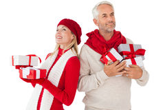 Smiling couple in winter fashion holding presents Royalty Free Stock Image