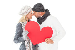 Smiling couple in winter fashion posing with heart shape Stock Photos