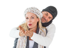 Smiling couple in winter fashion posing Royalty Free Stock Images
