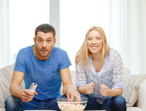 Free Smiling Couple With Popcorn Cheering Sports Team Stock Photos - 39659133