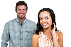 Smiling couple with woman in foreground Stock Photography