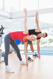 Smiling couple working out together Stock Photography