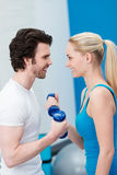 Smiling couple working out together in the gym Stock Photography