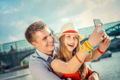 Smiling couple. Young smiling couple doing selfie Royalty Free Stock Images