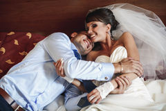 Smiling couplea is lying on the bed Royalty Free Stock Photography