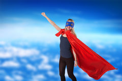 Smiling courage woman in superhero costume. Royalty Free Stock Image